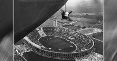 The propeller and lower shell of the Hindenburg Zeppelin are seen soaring above Berlin stadium during the 1936 Summer Olympic Games.