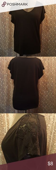 Casual Black Top by Pure Energy Casual Black Top by Pure Energy Size 1  Sleeves have lace and crochet on top Super cute Good condition Pure Energy Tops