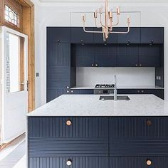 Infinity Blue fronts in Parallels pattern in this kitchen by @rlarchitects. Circus handles in solid, untreated copper. The kitchen is built on the ecellent Ikea Metod kitchen cabinets!