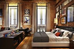 How amazing are those #window treatments in this #brick #loft style #apartment? Just gorgeous!