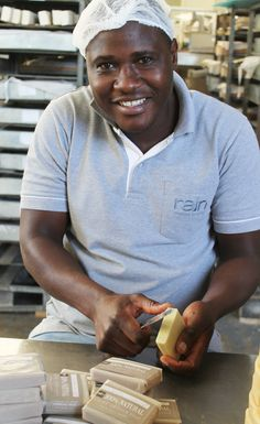 Meet Happy! He is one of our artisan soap makers.   Our distinctive, creative handmade soaps are a signature of the Rain brand.   Crafted from 100% natural ingredients, cured for up to six weeks, and passing through about eight pairs of skilled hands during their creation, these soaps underscore Rain's commitment to high quality through labour-intensive, low-tech manufacturing. Beauty Without Cruelty, Soap Maker, Beauty Industry, Handmade Soaps, Natural Skin Care, Artisan, Rain, Meet, Hands