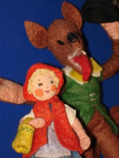 """Close-up of 3.5"""" Red Riding Hood and 6.5"""" Wolf stuffed felt dolls, from the BAPS series of cloth dolls, Germany, 1946-50, by Frau Edith von Arps."""