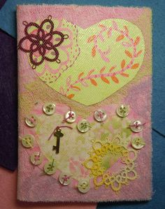Fuse  used misty fuse and tulle .... paper, tatting, buttons, charm