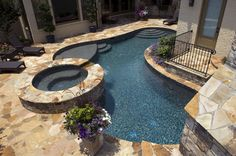 Dark bottomed swimming pools - when I can afford a pool this would be the look I would want to build.