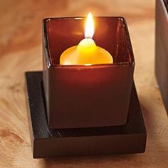 Ebony Oud Votive Holder - A dark finish and modern square lines lend our votive holder a masculine feel. Sprayed-brown glass votive cup sits in a handsome wooden tray. For tealights and votives, sold separately. Votive Holder, Glass Votive, Online Outlet, Tea Lights, Tray, Fragrance, Handsome, Candles, Brown