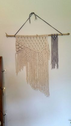 Check out this item in my Etsy shop https://www.etsy.com/listing/293526047/macrame-wall-hanging-on-driftwood