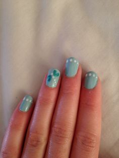 Turquoise dragonfly nails