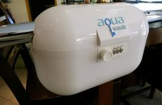 Aqua-Vault - This portable durable plastic lockbox fits securely around beach furniture, bikes and fences, and fits most of your personal items, so you can go and frolic in the waves knowing that your stuff is securely stowed away.