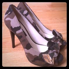 Sexy Camouflage heels Amazing camouflage heels size 6. They run big, so they would best fit a true 6.5. Worn 1 time and in excellent condition. Comes with original super cute zebra shoe box. wild diva Shoes Heels