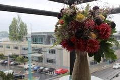 The view from my new urban balcony - a ceramic stool is the ideal pedestal for my summer bouquet Ceramic Stool, Pedestal, Design Projects, Balcony, Christmas Wreaths, Floral Design, Bouquet, Urban, Holiday Decor