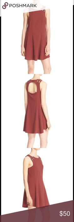 NWT Free People dress Size medium, great mini dress, color is a brick red, cut out back and grommets in front over shoulder, great fit Free People Dresses Midi