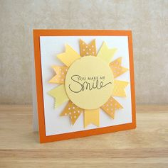 ribbon banners surrounding sentiment resembling sun; You Make Me Smile by Amy Wanford, via Flickr