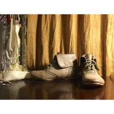 Pale olive ankle booties. These booties are perfect for fall or spring. They're lace up, ankle booties with a hint of olive. They have very cute floral detail on the inside of the boot. Match them with your favorite pair of leggings or skinny jeans. Only worn once. Shoes Ankle Boots & Booties