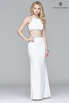 Faviana style S7926 is a dazzling two-piece Perfect for every body shape the tight crop top showcases beading and gems along the edges and the lace-up back has beading sprinkled over the mesh This jersey dress is available in ivory/gold navy and wine Pair with gold or silver tear drop earring  Faviana Glamour