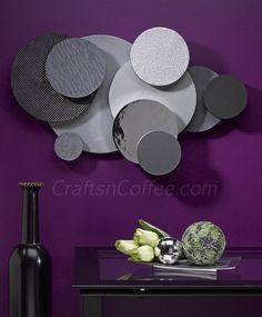 Super cool wall art -- can you believe this is textured paper and discs of STYROFOAM? No metalworking involved! On Crafts 'n Coffee.