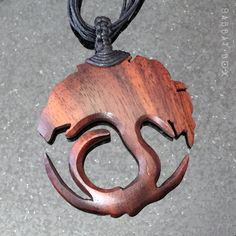 This Tree of Life necklace has been beautifully carved from wood and comes with a multi-strand cord. It has been stained in an elegant mahogany making this a striking piece for both men or women. One