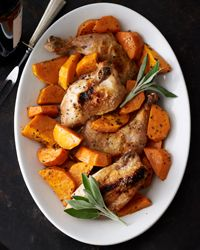 Roast Chicken with Butternut Squash Recipe from Food & Wine {Chicken quarters roasted with golden squash and sage are nice for a chilly autumn evening. To help the squash to brown evenly, be sure to spoon off the fat from the roasting pan after removing the breasts. This is a case where less is more: A thin layer of fat will brown the vegetable better than a quarter-inch of it.}