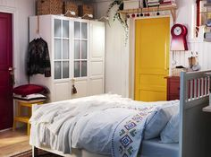 Pops of yellow #door #stool #white #scandinavian #bedroom