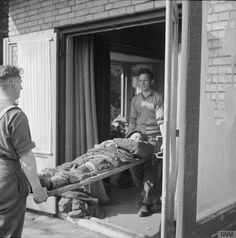 OPERATION 'MARKET GARDEN' - THE BATTLE FOR ARNHEM, SEPTEMBER 1944/ Our wounded being brought into the front line dressing station at Wolfheze.  © IWM (BU 1158)