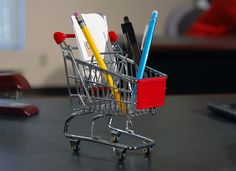 Attention Shoppers! This Mini Shopping Cart will delight shopaholics with its adorable miniature design. Durably constructed of gleaming metal and red rubber accents to resemble a handy shopping cart, this miniature shopping cart features a pull-out child seat and real rolling wheels. Place the mini shopping cart on your desk, in the kitchen or any [...]