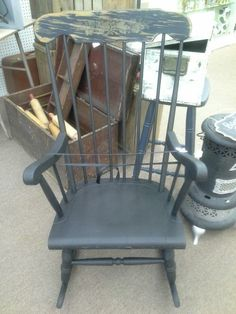 "SOLD - Shaker spindle back rocking chair painted black with heavily distressed head rest. Measuring approximately 24"" across by 28 1/2"" deep by 40"" at tallest point.  It can be seen in booth G9 at Main Street Antique Mall 7260 East Main Street ( E of Power Rd ) Mesa, AZ 85207 480 9241122open 7 days a week 10a.m to 5 : 30p.m Cash or charge accepted"