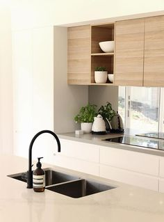 Get the lowdown on stone, concrete, Caesarstone laminate, stainless steel kitchen benchtops and more, to help you find out how to choose the best surface for your home. Kitchen Benchtops, Kitchen Cupboards, Kitchen Sink, Black Kitchens, Home Kitchens, Kitchen Black, Modern Kitchens, Kitchen Living, New Kitchen