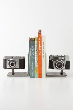Vintage Camera Bookends #anthropologie  finally a use for the vintage cameras I have!