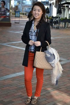 This woman pulls off pattern mixing really well.  I love the colored jeans, too.