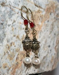 """Enchanting """"Old World"""" styled genuine pearl earrings in antique bronze by Maru Jewelry Designs are the perfect fashion accessory for daily wear. The red crystal adds to the warmth of the antique bronz"""