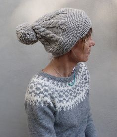 This cosy hat is knit from bottom up by beginning with a brim in garter stitch.