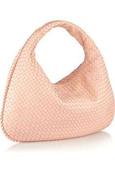 This Bottega Veneta woven everyday bag is the right size for our catch-all lifestyles! With one zip you can cover up all of our daily must haves.