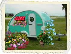 teardrop trailer ~ my dad has always wanted one of these, although I'm sure minus the flowers!!!