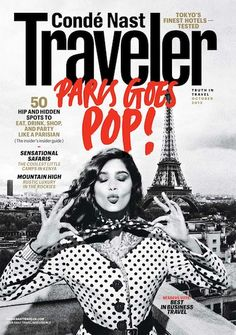 """We love the splash of red on Traveler's October cover. We also like to imagine that this pose is standard for most people in Paris. Seems about right."""