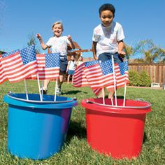 Fourth game: put buckets of sand on far end of yard w/ flags in them. On cue, the first kid from each team races to the appropriate bucket, plucks a flag, and marches back to his team as quickly as possible (no running allowed!) to tag the next person. 4th of July beam bag toss with old jeans and paper plates