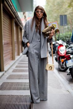 One of those unexpected street style hits: all gray done up in pinstripes and luxe wool.  Street Style Spring 2013 - Milan Fashion Week Street Style - Harper's BAZAAR