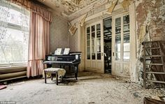 Unfinished symphony: Lacy and ruffled curtains remain open from the morning they were drawn it the piano room of the abandoned house