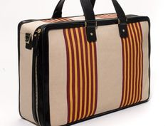 """It's back! The """"Chief"""" stripe of the Oshkosh Trunk Company, once the go-to luggage of America's traveling class."""