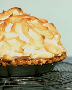 My fav for Easter Sunday - Martha Stewart Mile High Lemon Merangue Pie This whimsical pie sets the bar high for taste and appearance: It has a zesty lemon filling -- Martha's favorite -- a flaky pate brisee base, and a glossy Swiss meringue crown. Lemon Pie Recipe, Lemon Recipes, Pie Recipes, Dessert Recipes, Martha Stewart Lemon Meringue Pie Recipe, Mile High Lemon Meringue Pie Recipe, 13 Desserts, Lemon Desserts, Delicious Desserts