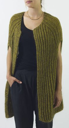 Knitting Pattern for Easy Francis Vest - Easy cocoon vest pattern is knit in Fishermen's rib and is a quick knit on large needles. Woman's S (M, L)