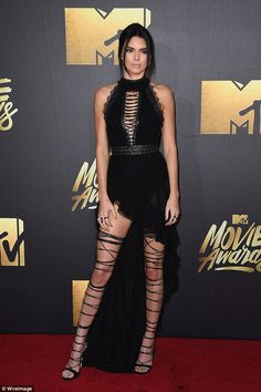 Leggy display! The supermodel showed off her slim pins in the provocative sheer black gown...