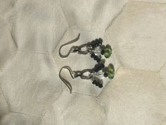 sterling silver loop EARRINGS faceted green aurora borealis crystal rondells + faceted clear crystal cubes on Etsy, $21.00