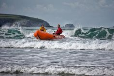 Escape from the waves! Surf rescue training at Whitesands beach, Pembrokeshire.