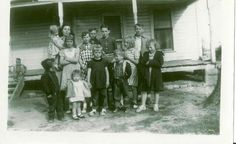 Group at Frank Warnick's house -1953  Aunt Agnes (Warnick) Crow holding Mary.  Carolyn, Linda Ruth, Frank, Jimmy, Pearl, Kenneth, Louise, --in front boy? Mary, Wilma Lee, Junior-unknown boy on  porch (Gary). Pearl ( Warnick) Brooks' sister, Agnes, and her children along with six or seven other siblings ( all Warnicks).