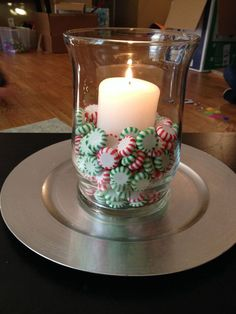 Easy Christmas Decor! Peppermints  Spearmints unwrapped in a hurricane votive, with a pillar candle nestled in the center!