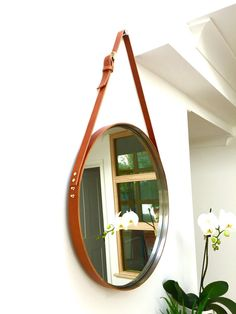 Round havana mirror at horchow round wall mirror with for Mirror hanging kit