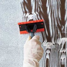Painting faux woodgrain. -- may repaint a dresser with chocolate brown and silver overlay