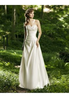 This brand new custom made satin a-line wedding dress features strapless sweetheart neckline adorned with beadings, rouched bodice and soft pick-up skirt. Please be kindly informed that this dress cost excludes any accessories like petticoats, gloves, veils, jackets, crowns, necklaces and so on.