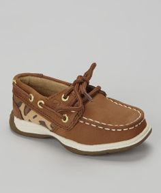 Walking the line between classic and contemporary is a cinch for these boat shoes. With classic laces and a sprinkling of leopard spots, this pair will bring playful and polished style to a little one's look.