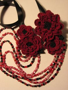 Beaded necklace with crocheted flowers