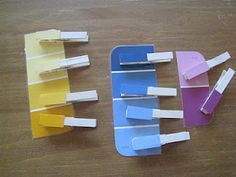 laminated paint chips and clothes pins.  Glue a small strip of color onto the clothes pin and the kids match up the colors.